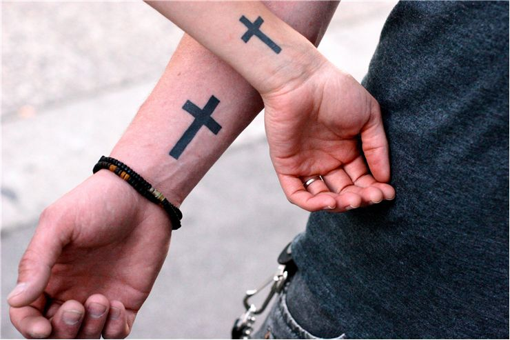 Picture Of Matching Cross Symbol Tattoos